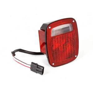 Lighting - Tail Lights - Omix-Ada - Omix-Ada Tail Light, Left, Black Housing; 98-06 Jeep Wrangler TJ 12403.47